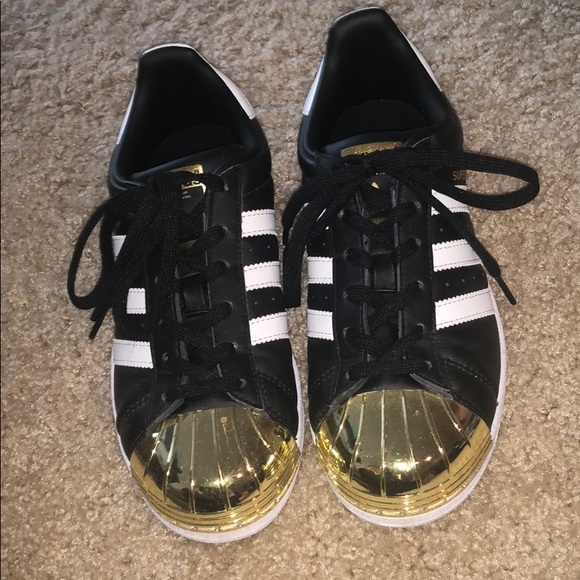 Black and gold Adidas Superstars special edition